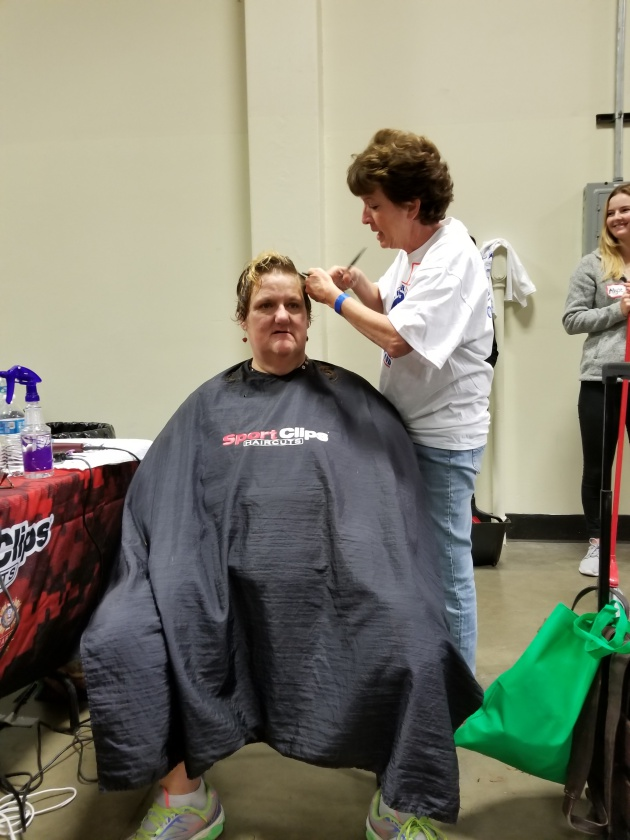 "Lompoc resident and Air Force veteran Linda Hernandez gets a haircut from Denise Farer during the Santa Barbara County Stand Down. ""The privilege to give back to our veterans who served (our country) and serve them as they served us (is why I do it),"" Farer says."