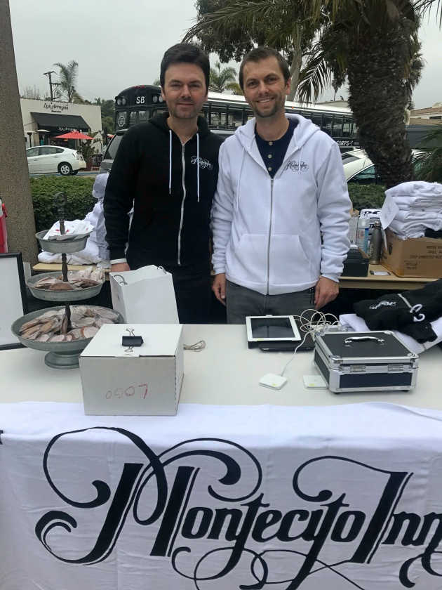 Brothers Danny and Jason Copus manned a table selling merchandise from their historic hotel, the Montecito Inn.