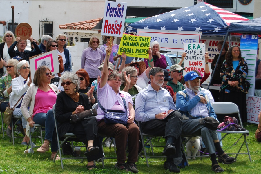 "Signs, symbols of defiance and ""pussyhats"" were much in evidence at Sunday's rally for the Equal Rights Amendment."