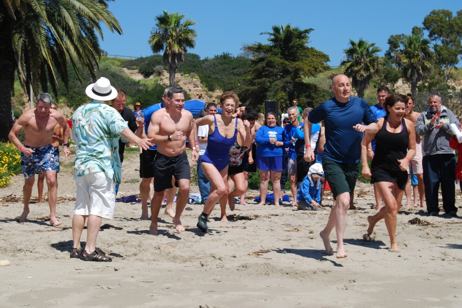 Santa Barbara County District Attorney Joyce Dudley leads her team into the water as part of Saturday's Polar Plunge benefit for the Special Olympics Southern California-Santa Barbara Region.