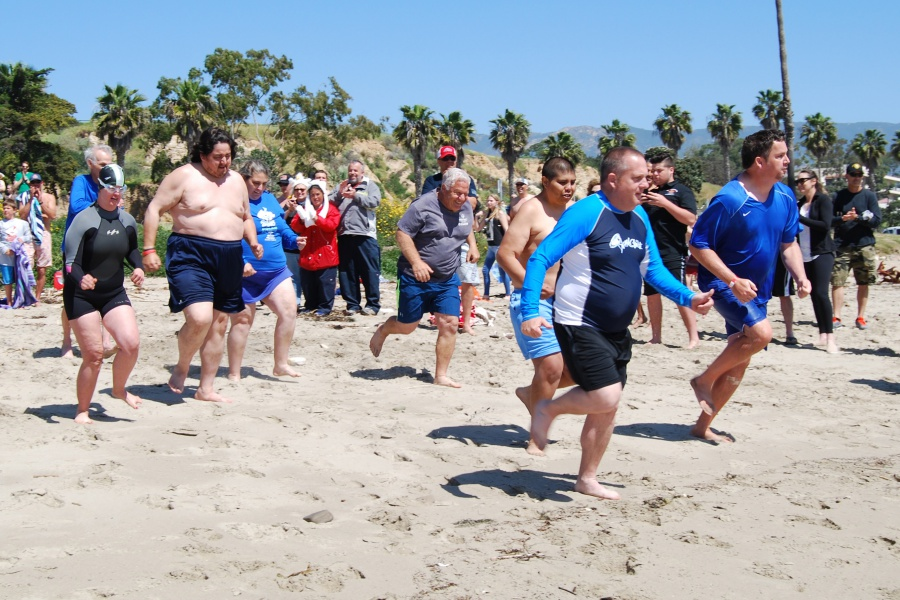 Special Olympics Santa Barbara athletes and supporters ran into the Pacific Ocean on Saturday afternoon as part of the third annual Polar Plunge fundraiser at Leadbetter Beach.