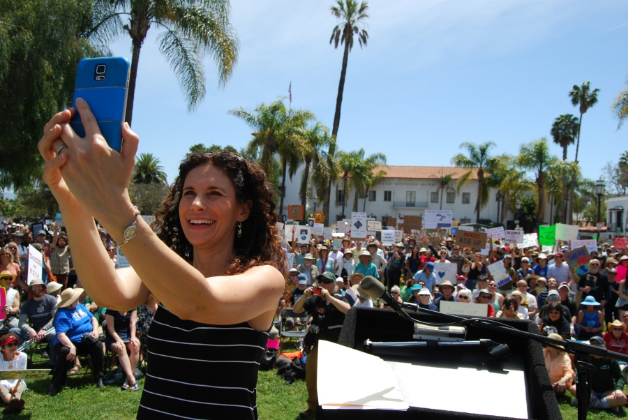 Goleta Union School District board member Susan Epstein, the emcee of Saturday's March for Science rally at De la Guerra Plaza in Santa Barbara, pauses to take a selfie with the crowd.
