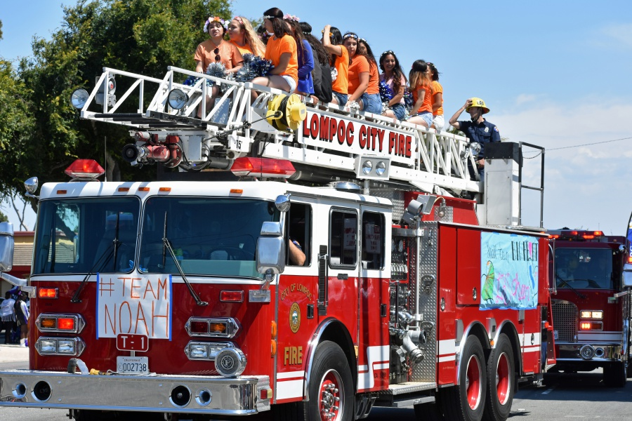 Several entries in Saturday's Lompoc Valley Flower Festival Parade displayed support for Team Noah, including Lompoc High School cheerleaders hitching a ride aboard a Lompoc Fire Department truck. Team Noah, symbolized byt the color orange, is a show of support for Noah Scott, who has been battling cancer.