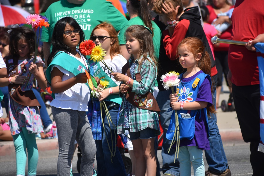 Girl Scouts are armed with flowers for their walk in the Lompoc Valley Flower Festival Parade on Saturday.<br />