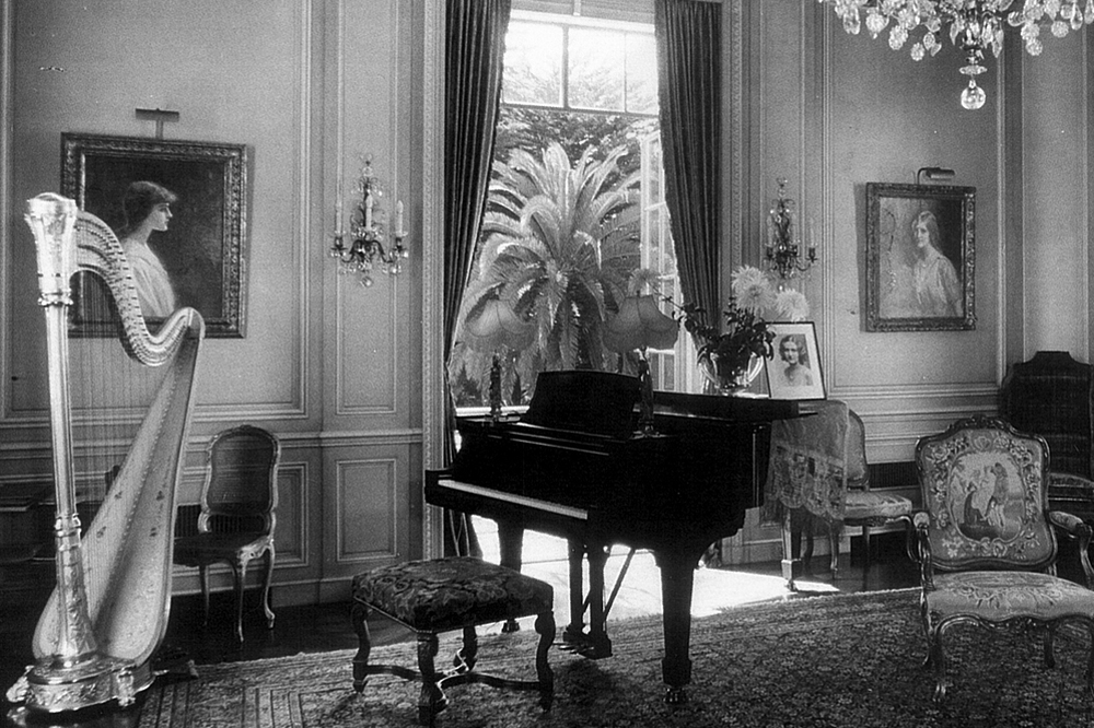 Many musical instruments, pieces of artwork and furniture are for sale in the December Millea Bros. auction, including a Steinway piano and crystal wall sconces that look similar to the ones seen in this 1940s-era photograph of the music room in Bellosguardo, the Clark family's Santa Barbara estate.