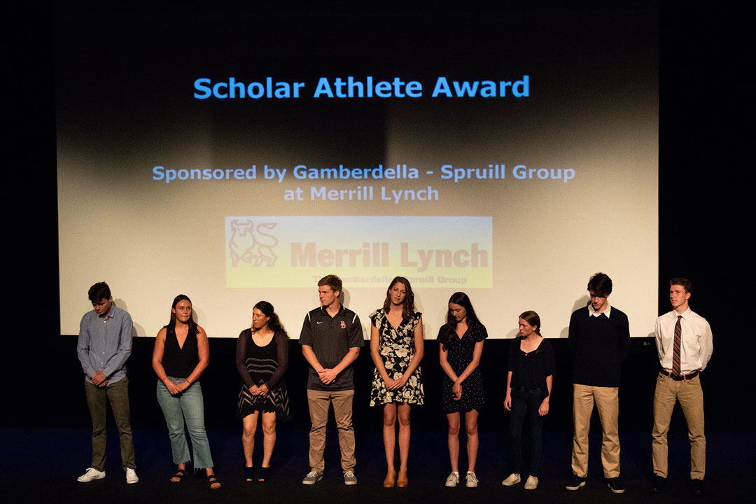 Athletes on stage at awards ceremony.