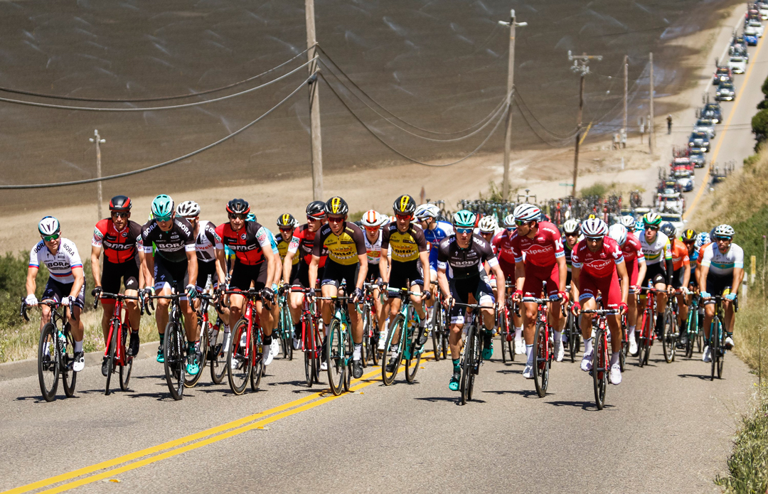 Racers in the Tour of California climb up onto the Nipomo Mesa during the third stage of the Amgen Tour of California which started in Pismo Beach and finishes in Morro Bay.<br />