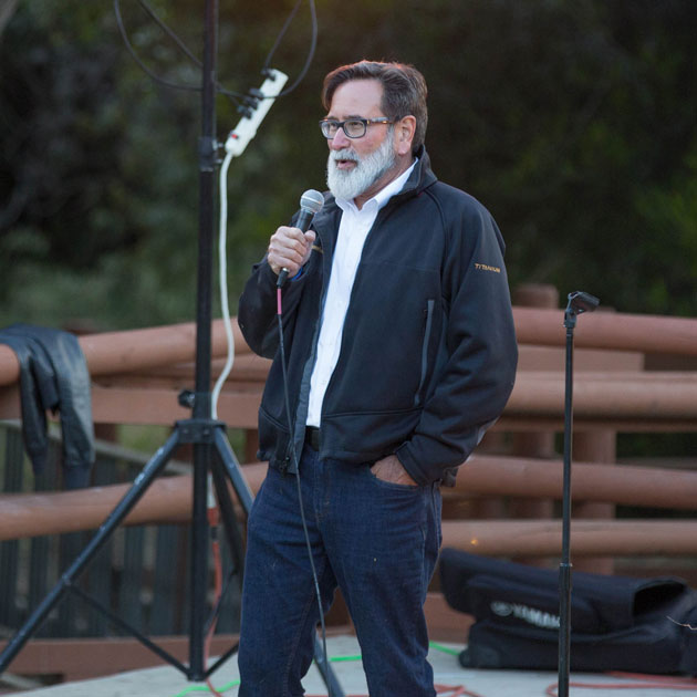Richard Martinez, who son Christopher Michaels-Martinez was among six UCSB students killed during the Isla Vista Massacre three years ago, speaks to the crowd Tuesday night during a cermony honoring the victims.