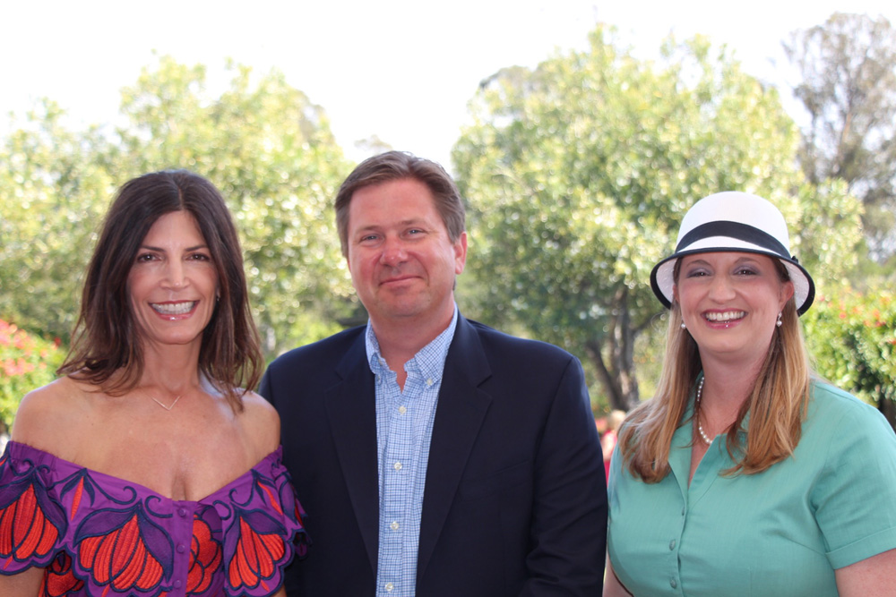 Event co-chairs Emily Jones, left, and Bryan Goligoski with Casa del Herrero Executive Director Jessica Tade at the Feria Andalusia Art Show & Garden Fair held June 4 at the organization's Montecito grounds.