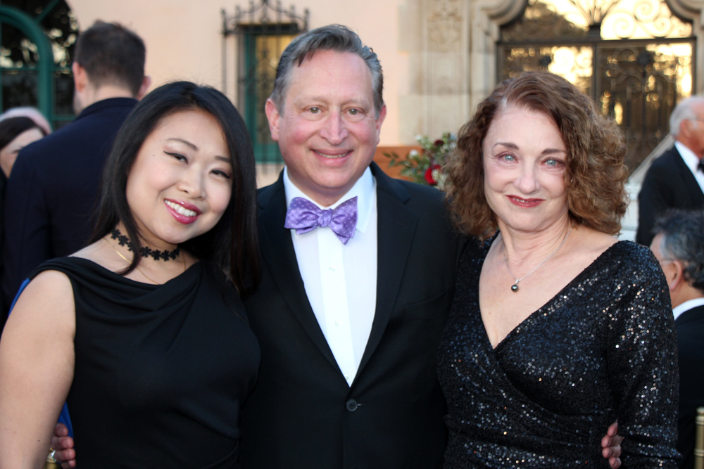 Yiwen Li, left, with Ron and Andrea Gallo.