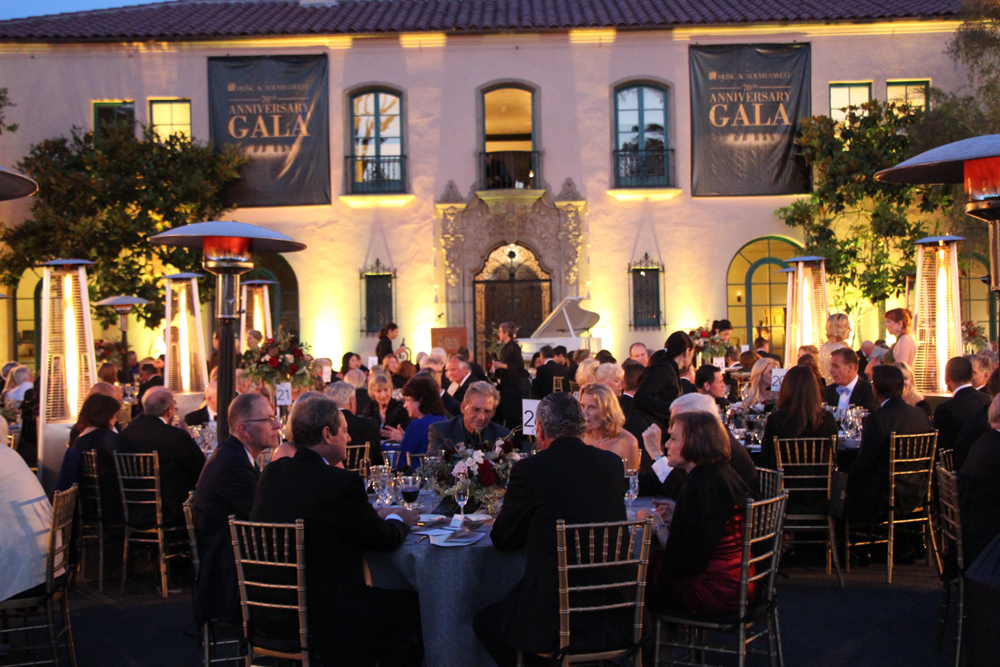 Guests dine beside the Marilyn Horne Main House at dusk.