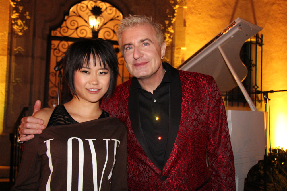 Special guest artists and acclaimed pianists Yuja Wang and Jean-Yves Thibaudet pose in front of an Ivory Steinway concert piano, one of 55 pianos acquired for the academy for use on its campus and in the community.