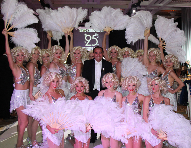 Storyteller's Supper Club emcee, Ricardo Calderon, poses with dancers at a 1930s-themed fundraiser benefiting Storyteller Children's Center held Friday at Bacara Resort & Spa.