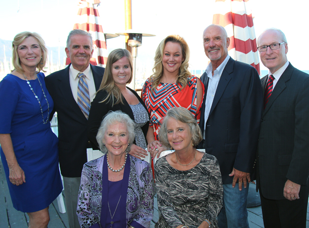 Top row from left, Lynda Tanner, president and CEO of Visiting Nurse & Hospice Care, Don and Dee Dee Barthelmess, Carol Kallman's husband and Don and Carol's daughter, with Robyn Parker, Santa Barbara Yacht Club Charity Regatta chair; Tom Parker, SBYC Charity Regatta past chair, and Rick Keith, VNHC Foundation executive director; bottom row from left, Ruth Kallman, Robert Kallman's widow, and Carol Kallman, SBYC member and Caring Heart Award honoree.