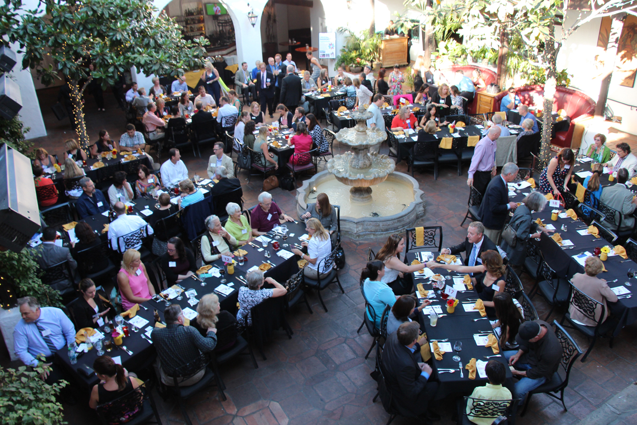 Guests gathered in the historic courtyard of El Paseo Restaurant for the annual awards and board meeting.